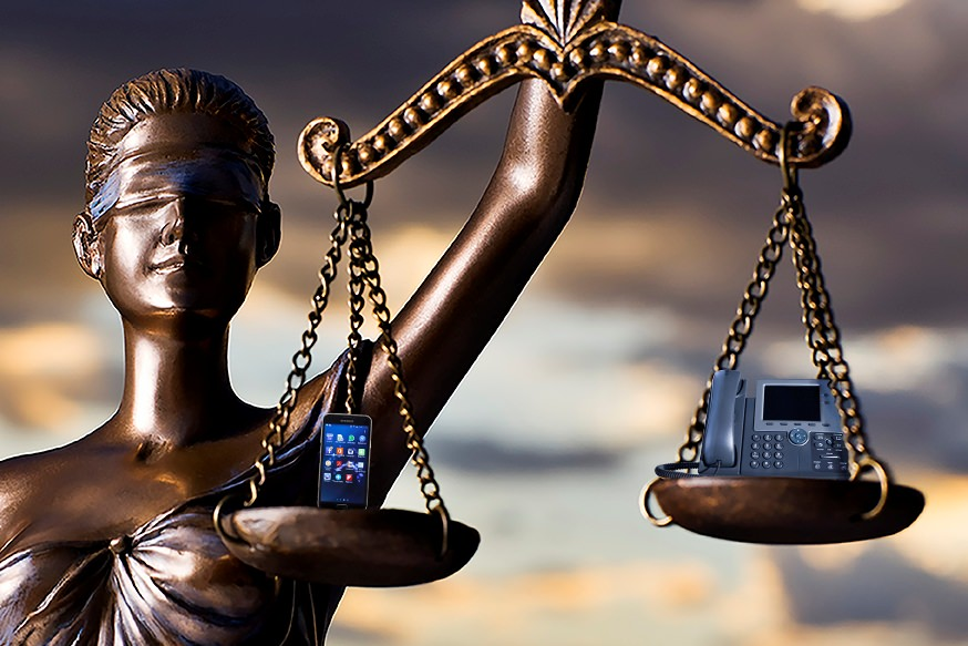 Statue of the scales of justice balancing a consumer cell phone versus a business phone
