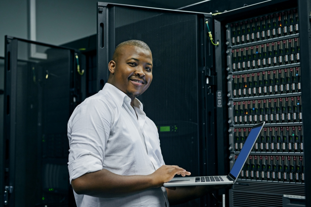 technician examines call center file servers