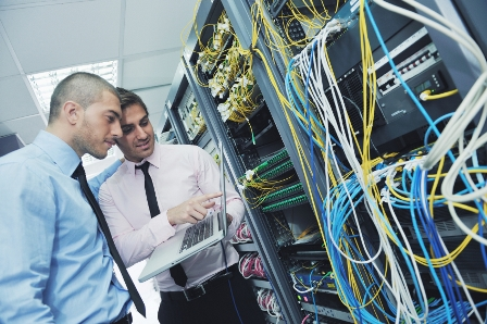 Two engineers evaluate telecommunications wiring